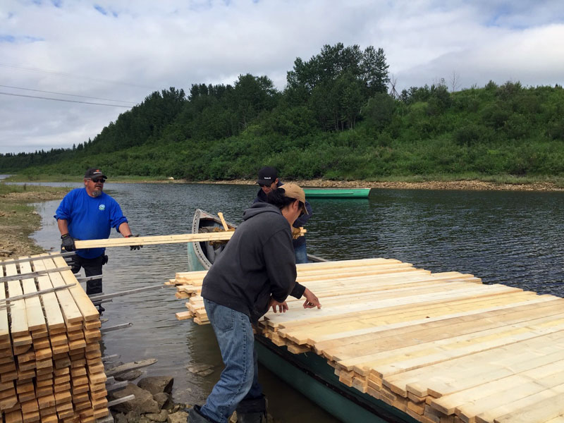 Hydro conservation partners: Community members shipping strapping to Kashechewan from Fort Albany