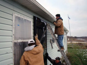 Installing the solar panel on a Fort Albany home.